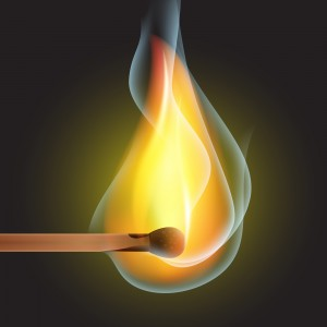 Burning match on a black background vector
